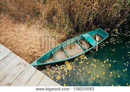 River And Rowing Fishing Boat Near Cost In Autumn Day. Top View