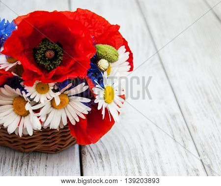 bouquet of wildflowers on a old wooden table
