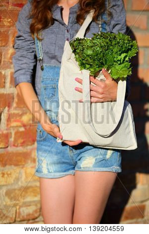 Linen Bag With Fresh Lettuce Salad In Woman Hands