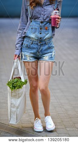 Linen Bag With Lettuce Salad And Smoothies Disposable Cup In The Hands Of Sexy Woman