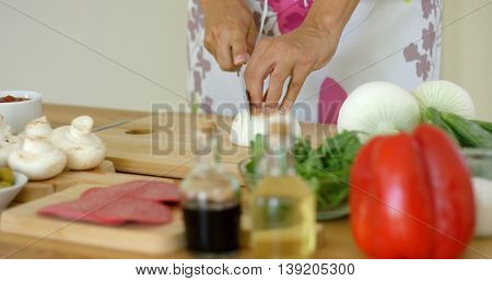 Close up on hands Cutting fresh onion