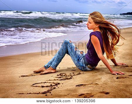 Summer girl sea. Teenager writting love on sand. Summer dreams of girl on sea beach.