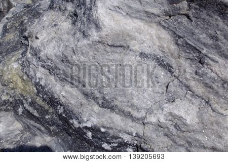 Texture raw surface of white marble. Background  raw white marble stone in its natural form. Semi-precious stone material for making buildings and interior. Industrial raw materials marble.