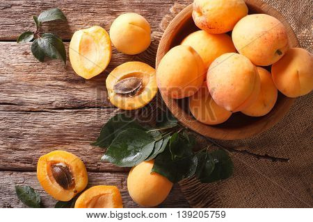 Fresh Apricots In A Wooden Bowl On The Table Close-up. Horizontal Top View