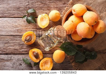 Apricot Kernel Oil In A Glass Jar Closeup. Horizontal Top View