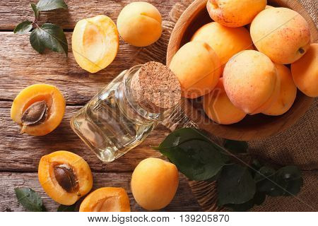 Healthy Apricot Oil In A Glass Bottle Macro. Horizontal Top View