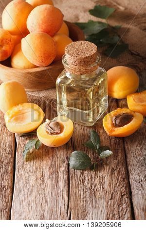 Apricot Kernel Oil In A Glass Jar Closeup And Ingredients. Vertical