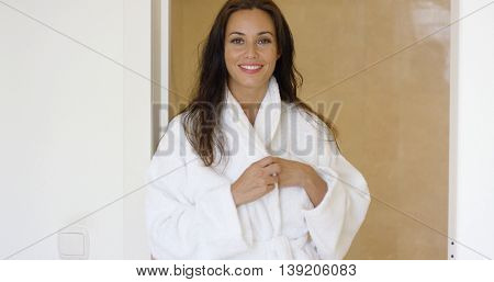 Gorgeous female adult adjusting bath robe