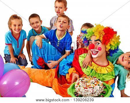 Birthday clown with group children keeps birthday cake .Celebration of children birthday . Isolated.