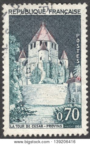 MOSCOW RUSSIA - CIRCA JANUARY 2016: a post stamp printed in FRANCE shows a view of the Caesar Tower in Provins town of medieval fairs in Seine-et-Marne the series