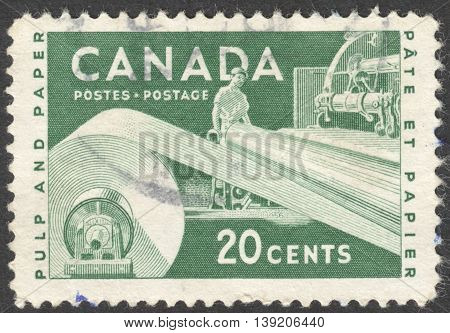 MOSCOW RUSSIA - CIRCA JANUARY 2016: a post stamp printed in CANADA shows the Pulp and Paper the series