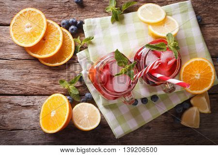 Refreshing Sangria With Orange, Strawberry And Blueberry Closeup. Horizontal Top View