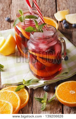 Cold Alcoholic Drink Sangria Close Up In A Glass Jar. Vertical