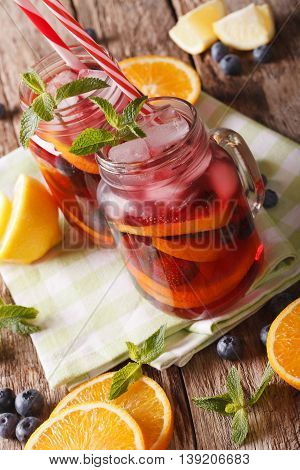Citrus Sangria With Ice And Mint Close Up In A Glass Jar. Vertical