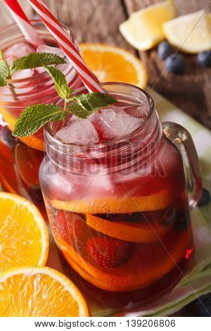 Sangria With Citrus, Strawberry And Blueberry Macro In A Glass Jar. Vertical