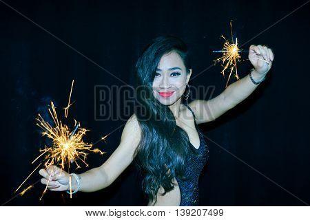 Joyful gorgeous girl with two bengal lights