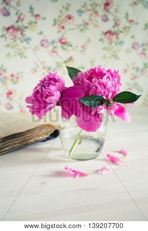 Fresh Bouquet Of Peonies In A Glass Jar On A White Wooden Table. Book And A Cup Of Tea