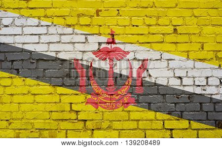 Flag of Brunei painted on brick wall background texture
