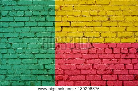 Flag of Benin painted on brick wall background texture