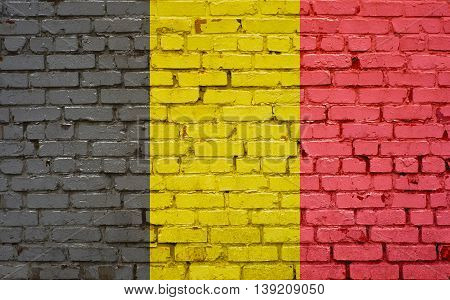 Flag of Belgium painted on brick wall background texture