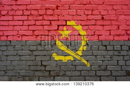 Flag of Angola painted on brick wall background texture