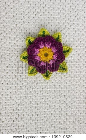 White crochet background with flower place for text