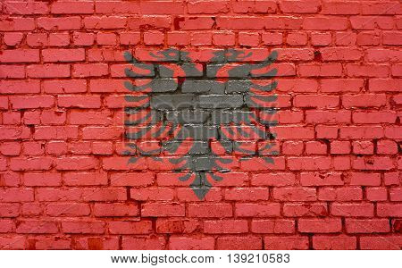 Flag of Albania painted on brick wall background texture