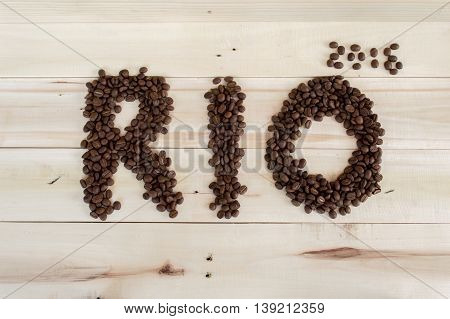 Olympics Rio 2016 Coffee Beans Alphabet Text On The Wood Background.