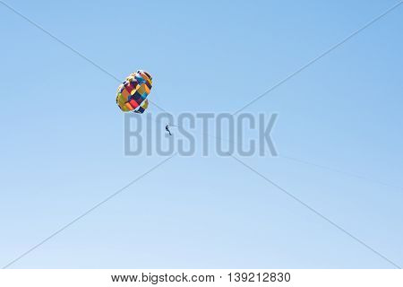 Parasailing summer sport. Parachute and boat. High in the sky