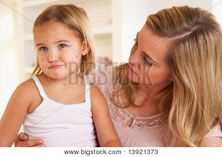 Mother nursing sick child