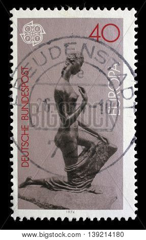 ZAGREB, CROATIA - JULY 03: A stamp printed in the Germany shows Kneeling Woman, Sculpture by Lehmbruck, circa 1974, on July 03, 2014, Zagreb, Croatia