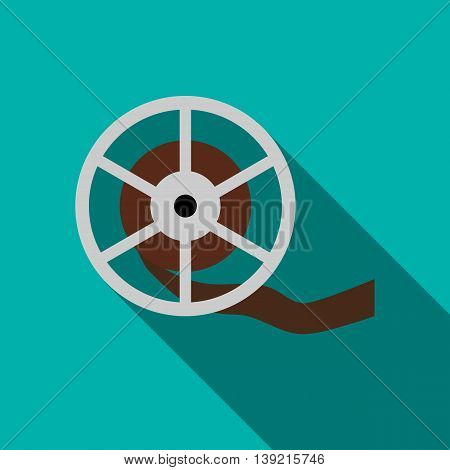Film reel icon in flat style on a turquoise background