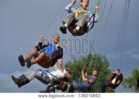 People In Merry Go Round, Swing Ride, Highland Spinner