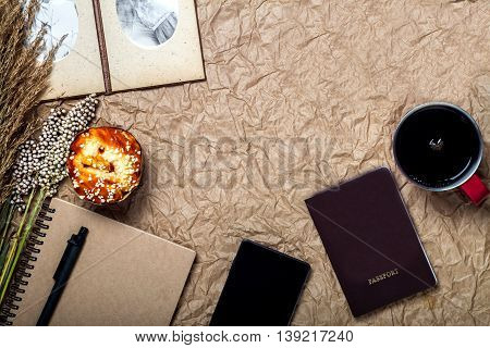 Travel and gadget vacation with mobile passport on brown paper background vintage and retro style