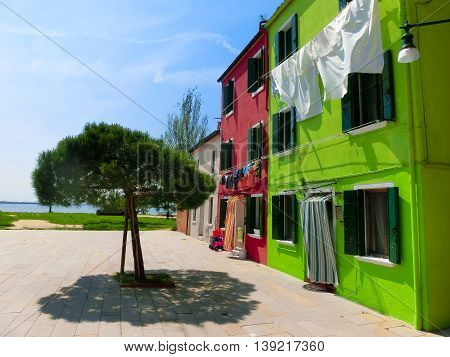 The colorful facades of houses at Burano, an island in the Venetian Lagoon, Italy