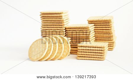 Rectangular and round crackers on white background