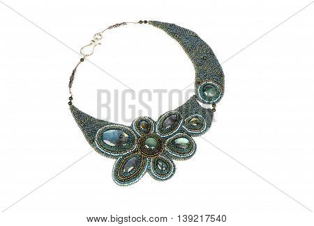 Jewelry. Beaded necklace with green stones isolated on white background
