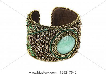 women's jewelry handmade work. elegant female bracelet isolated on white background