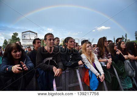 Rainbow Over Cheering Crowd