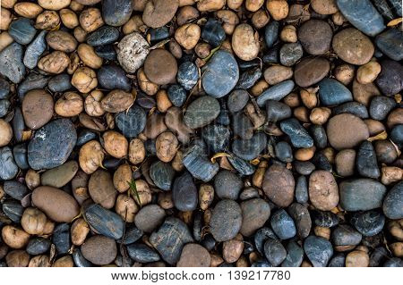 Pebbles small boulders texture pattern for background.
