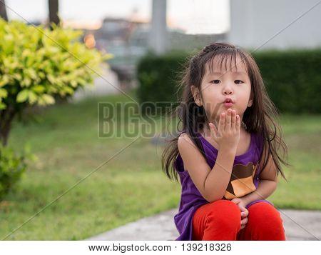 little asian cute girl, action sends kiss