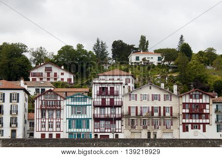 Houses between trees in a cloudy day in Saint Jean de Luz France