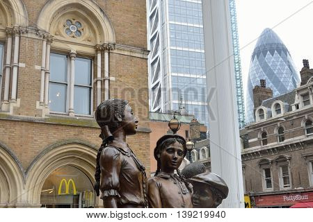 LIVERPOOL ST LONDON UK 16 September 2014: memorial in hope square with city in background