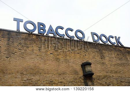 WAPPING LONDON UK 16 September 2014: Tobacco Dock sign over brick wall