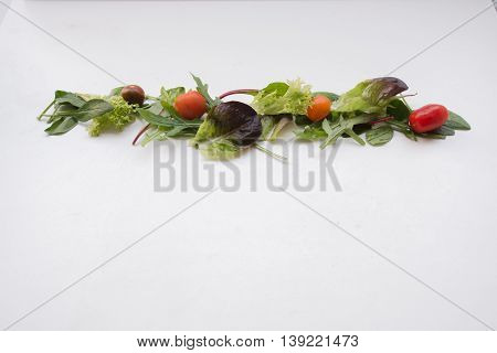 Cherry Tomato And Leafy Green Salad Arranged In A Line For A Border Or Pattern Composition