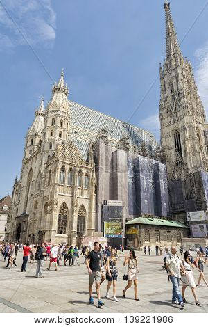 VIENNA, AUSTRIA, JULY 2,2016: People walking in front of St. Stephen's Cathedral, the most important religious building in Vienna, witnessing to many important events in Habsburg and Austrian history.