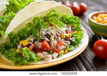 Mexican Tacos With Meat, Beans, Lettuce, Corn, Onion, Tomato And Cheese