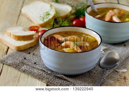 Tomato Soup With Salmon In A Ceramic Bowl, Bread And Tomatoes On A Wooden Boards Background.