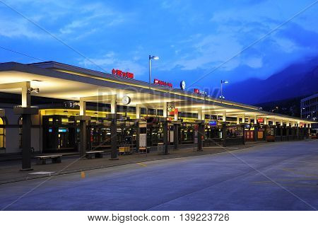 Chur, Switzerland - June 07, 2010: Exterior of the railway station at evening time.