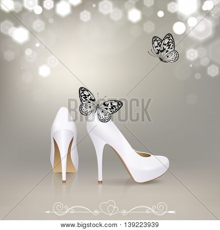 white high-heeled shoes with black and white butterflies